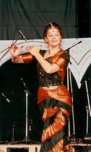Fabrizia portraying Krishna playing the flute